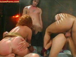 Asian babe gets double penetrated during group sex