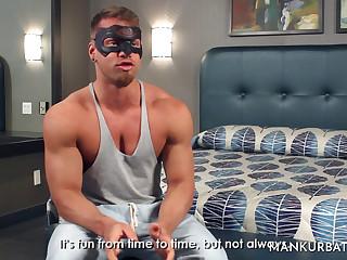 A bodybuilder strokes his penis