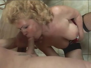 Busty granny gets down and dirty with young guy who has big cock