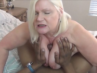 Lusty blonde granny decides to take on large black dick in her bedroom