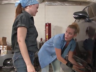 Slutty lesbians having fun in the public garage