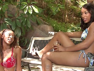 Two ebony nymphos pleasure each other with different toys