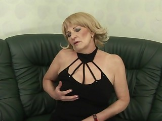 This horny housewife gets wet on her couch