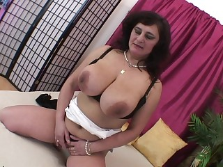 Horny big titted mature slut playing with herself
