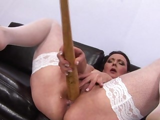 This mature slut gets a fist in her pussy