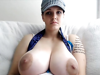 Sweet chick shows off enormous tits on camera