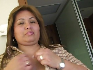 Chubby housewife playing on her bed