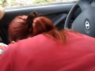 Russian redhead gives a head in a car