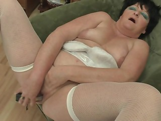 Chubby mama playing with her dildo