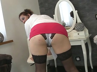Big breasted mature woman playing with herself
