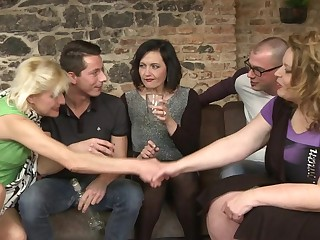 Two guys fucking three mature sluts in a groupsex session