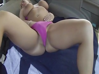 Massive tits milf masturbating with a dildo in the trunk