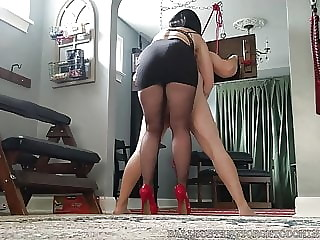 Bastienne Cross Bound and Ballbusted in Heels and Pantyhose