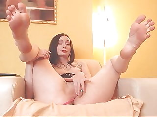 Russian brunette shows her soft soles and ass.