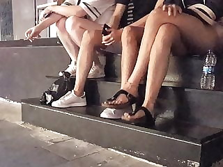 Sexy long crossed legs, sexy feets dangling