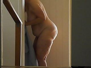 Gran naked entering shower.