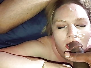 Bust on her face with her husband watching