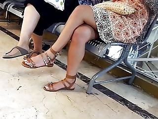 crossed hot legs, sexy pedicured white  feets toes