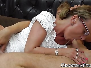 Classy granny lets her young lover fuck her in many poses