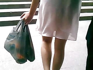 White transparent dress walking on the street