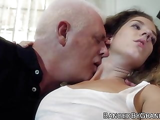 Young babe with long hair rides grandpa and tastes his cum
