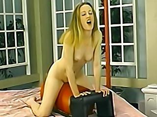 Petite amateur rides a sex machine until she orgasms