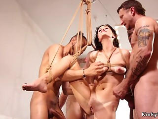 Bound brunette gets facials in interracial orgy